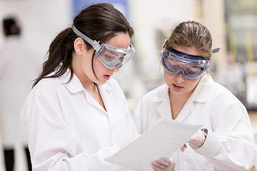 students wearing protective gear in lab
