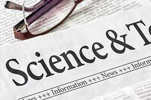 Image of Science section of newspaper on table