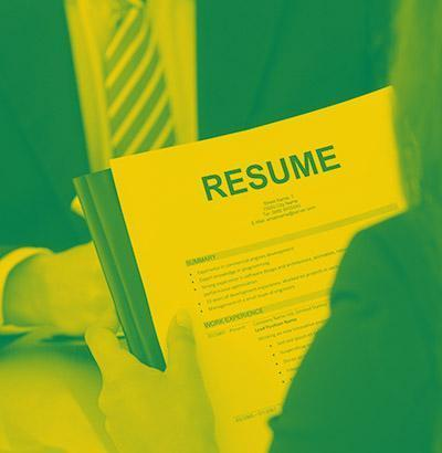 Student holding a resume